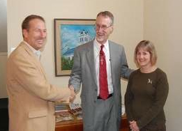Scott Pontier of the Center for Life Transitions (left) congratulates Todd Buurstra and Judith Wilkinson on their financial gift. (Photo by Roland Reinhart, Reinhart Marketing Group)
