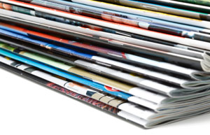 Stack of Business Publications - Translating Information to Intelligence